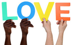 Multi ethnic group of people holding the word love Stock Images