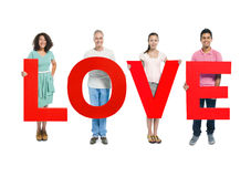 Multi-Ethnic Group of People Holding Word LOVE Royalty Free Stock Photos