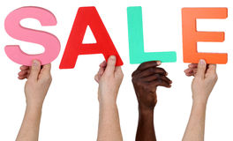 Multi ethnic group of people holding the word Sale Stock Image