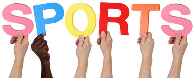 Multi ethnic group of people holding the word sports. Isolated royalty free stock photo