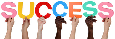 Multi ethnic group of people holding the word success Stock Photography