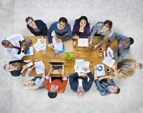 Multi-Ethnic Group of People in a Meeting Looking Up Stock Photography