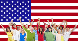 Multi-Ethnic Group Of People. Raising Their Arms With American Flag As A Background Stock Images