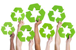 Multi-ethnic group of people's hand holding recycling symbol Royalty Free Stock Image