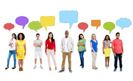 Multi-Ethnic Group of People with Speech Bubbles. Multi-Ethnic Group of People with Empty Speech Bubbles Royalty Free Stock Photography
