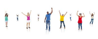Multi-Ethnic Group Of People With Their Arms Raised Standing Stock Image