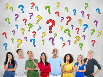 Multi-Ethnic Group of People Thinking and Question Marks.  Royalty Free Stock Image