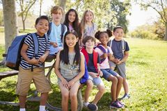 Multi-ethnic group of school kids hanging out on school trip royalty free stock photography
