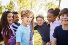 Multi-ethnic group of schoolchildren on a school trip royalty free stock photography