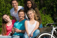 Multi ethnic group of sporty friends. Multi ethnic group of sporty teenage friends in a park royalty free stock images