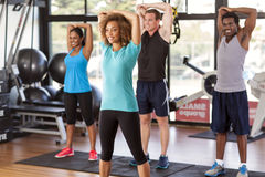 Multi-ethnic group stretching in a gym. Before their exercise class Royalty Free Stock Images