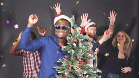 Multi ethnic group of students at Christmas party, slow motion. stock video footage
