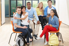 Multi-Ethnic Group Of Students In Classroom. Smiling Stock Photography