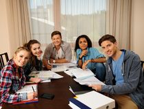 Multi ethnic group of students preparing for exams Royalty Free Stock Images