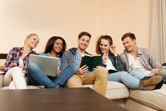 Multi ethnic group of students preparing for exams Stock Images