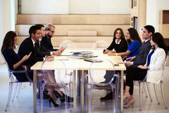 Multi ethnic group of successful business people discuss ideas during the meeting in modern office interior, Royalty Free Stock Photo