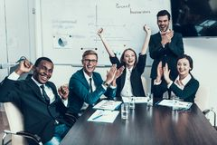 Multi ethnic group of successful business people rejoice at success in conference hall. Business Meeting. Encounter in Boardroom royalty free stock image