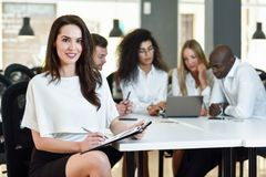 Multi-ethnic group of three businesspeople meeting in a modern o. Multi-ethnic group of five businesspeople meeting in a modern office. Caucasian businesswoman stock images