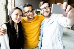 Multi-Ethnic Group of Young People Taking Selfie stock images