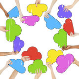 Multi-Ethnic Hands and Colourful Speech Bubbles Stock Images