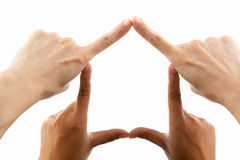 Multi ethnic hands forming house symbol Stock Images