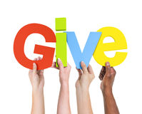 Free Multi-Ethnic Hands Holding The Word Give Stock Images - 39119464