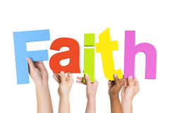 Multi-Ethnic Hands Holding The Word Faith Royalty Free Stock Photography