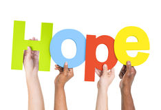 Multi-Ethnic Hands Holding The Word Hope. Multi-Ethnic Group Of People Holding The Word Hope Royalty Free Stock Photography