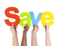 Multi-Ethnic Hands Holding The Word Save Stock Image