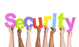Multi-Ethnic Hands Holding The Word Security Stock Photo