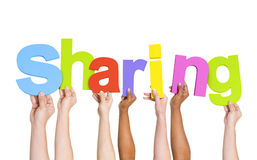 Multi-Ethnic Hands Holding The Word Sharing Stock Image