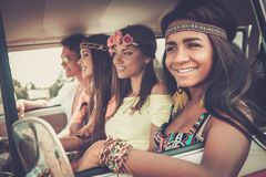 Multi-ethnic hippie friends on a road trip Stock Photos