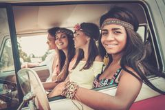 Multi-ethnic hippie friends on a road trip Royalty Free Stock Images