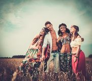 Multi-ethnic hippie friends in a wheat field Stock Images