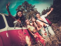 Multi-ethnic hippie hitchhikers Stock Image