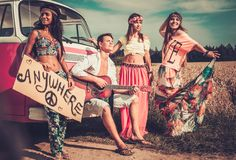 Multi-ethnic hippie hitchhikers Stock Photography