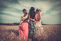 Multi-ethnic hippie travellers