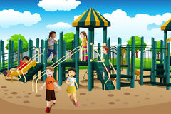Multi-ethnic kids playing in the playground Royalty Free Stock Photos