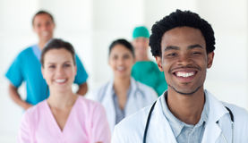 Multi-ethnic medical people smiling at the camera Stock Photography