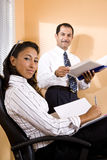 Multi-ethnic office workers in reviewing report Stock Photography