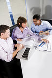 Multi-ethnic office workers working on project Stock Image