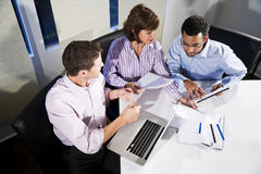Multi-ethnic office workers working on project Royalty Free Stock Photo