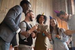 Multi-ethnic party people enjoying celebration, having fun holdi stock images