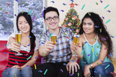 Multi ethnic people at a christmas party Stock Photography