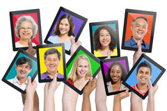 Multi-ethnic People On Digital Tablets Royalty Free Stock Images