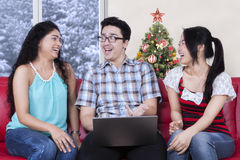 Multi ethnic people discussing with laptop at home Stock Photography