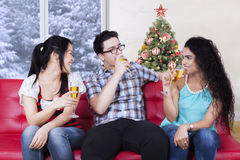 Multi ethnic people enjoy champagne together Royalty Free Stock Photo