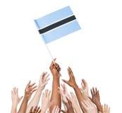 Multi-Ethnic People Holding The Flag Of Botwana Royalty Free Stock Image