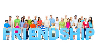 Multi-ethnic people holding Friendship letters Concept Stock Image