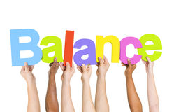 Multi Ethnic People Holding The Word Balance Royalty Free Stock Photo